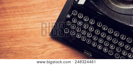 Vintage Typewriter Machine On Writers Desk, Top View Flat Lay Conceptual Image For Blogging, Publish