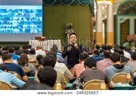 Asian Speaker With Casual Suit Standing And Giving The Knowledge With Audience In The Conference Hal