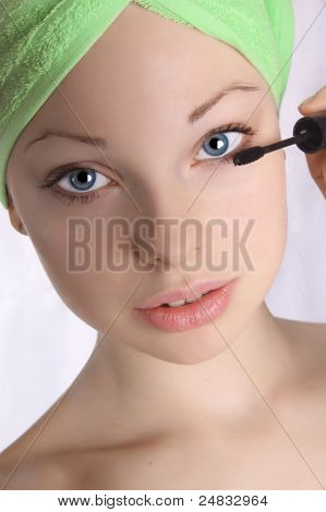 Girl in the towel doing make-up