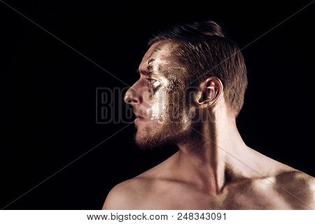 Body Art Paint With Gold On Face Of Man. Man Has Golden Body Art. Body Art Concept. Luxury Body Art