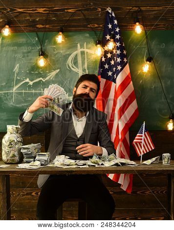 Economy And Finance. Economy Concept With Bearded Man Holding Money