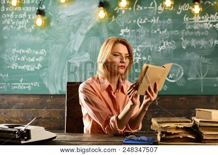 Love Story Novel Book In Hand Of Woman At School Lesson. Love Story Writing By Pretty Woman