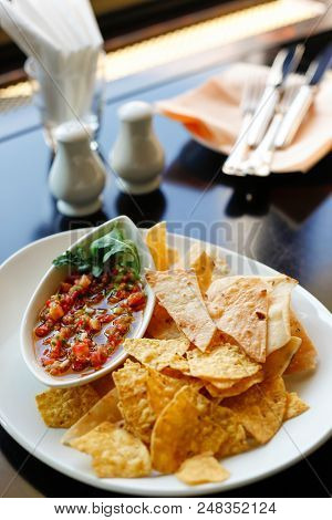 Tortilla With Tomato Salsa, Vertical, Served In Restaurant On Whiite Plate