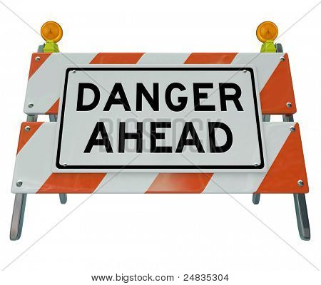 A road barrier reading Danger Ahead to signal that construction is on the road or public area and your way is blocked to caution and warn you from the work underway