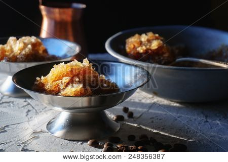 Dish For Dessert With Coffee Ice, A Bowl And A Grain On The Table Close-up. Sicilian Granite Horizon