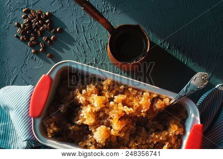 Form For Dessert With Coffee Ice On A Napkin And Coffee Beans. Sicilian Granite Horizontal