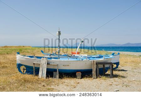 Old, Little Fishing Ships Are Standing At The Ground Next To The Sea In Sicily, Italy