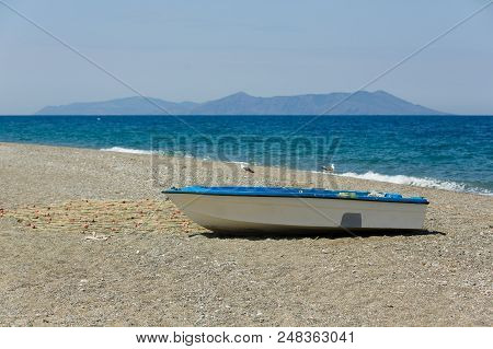 Small Fishing Boat With Fishing Web Parks At Beach Of Sicily, Italy