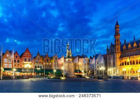 Typical Flemish Colored Houses And Statue Of Jan Breydel And Pieter De Coninck On The Grote Markt Or