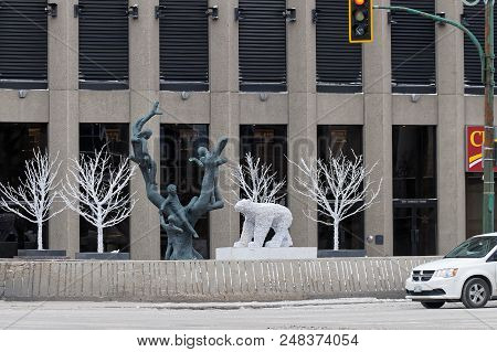 Winnipeg, Canada - 2014-11-17: Tree Children Sculpture By Leo Mol Surrounded By Winter Decorations I