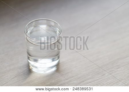 Glass Of Water On Wood Table With Light In The Morning, Healthy Care Concept, Selective Focus