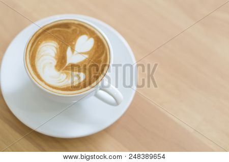 Closeup Top View Glass Of Latte Art Coffee Tulip Shape On Wood Background With Vintage Color, Select