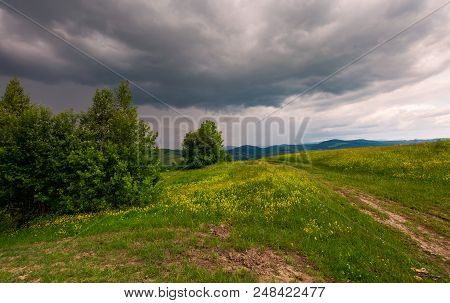 Path Across The Grassy Hill. Lovely Summer Scenery. Hiking And Outdoor Activities Concept. Dark Clou