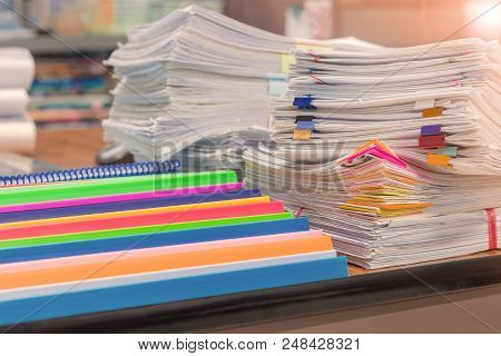 Pile Of Unfinished Homework On Teacher's Desk Waiting To Be Managed. Paperwork Pack Print Document O