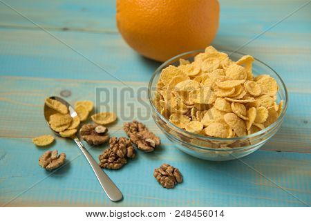 Healthy Corn Flakes With Milk For Breakfast With Fruit. Tasty Cornflakes Witt Walnut In Glass Bowl O
