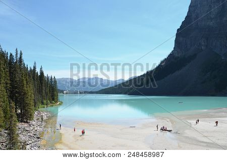 Lake Louise, Ab / Canada - July 26, 2017:  Tourists Explore The End Of Lake Louise Opposite The Fair
