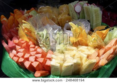 Huge Basket Of Fresh Fruit Cut Up For Snacks As Street Food