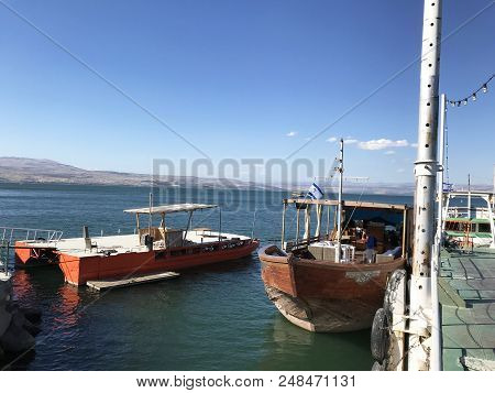 Tiberias, Israel - June 19, 2018: Tour Boats At Dock In The Sea Of Galilee. The Boats Take Tourists