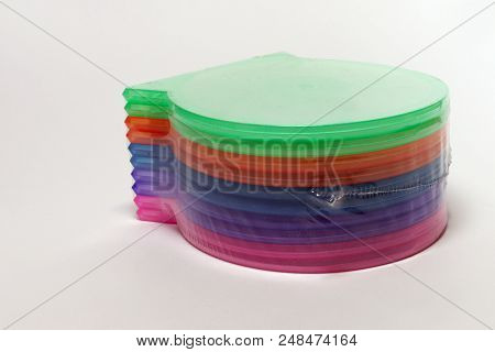 Packed Stack Of Multicolored Shells - High Quality Single Case For Cd Storing; With Clipping Path