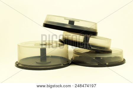 Storages With Spindel For Compact Disc. Small Capasity Boxes With Transparent Covers In Pile