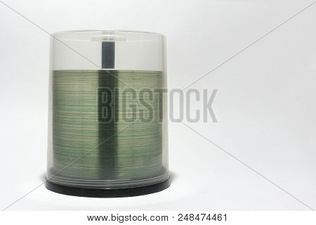 Transparent Rim Of Cds In Stack. Plastic Storage Tube With Blurry Visible Spindel Under Screwed Cove
