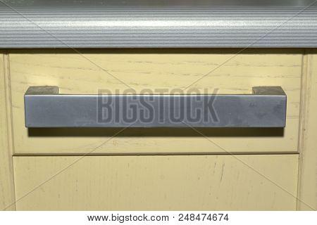 Kitchen Drawer Knob Under Striped Worktop. Flat Arch Large Handle With Sharp Corners. Silver Tone, M