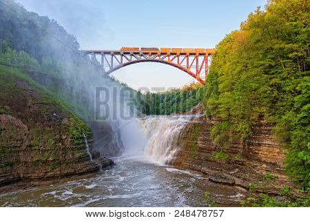 Train Crosising The Arch Over The Upper Falls At Letchworth State Park In New York