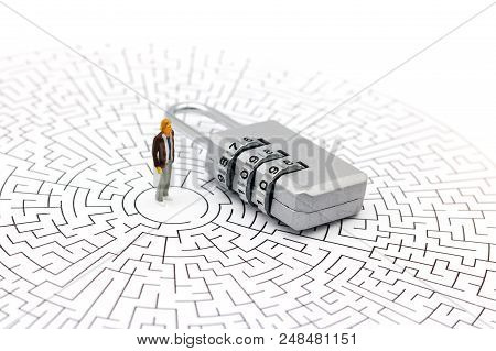 Miniature People: Businessman Standing On Center Of Maze With Key And  Thinking How To Solve This Pr