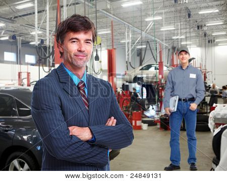 Professional auto mechanic  and manager in auto repair shop. Garage.