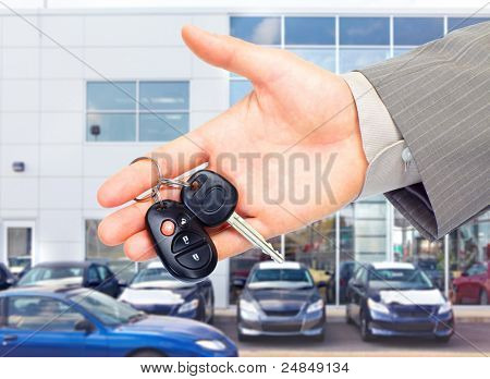 Hands with car keys. Dealer and client.