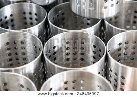 Table setting. Forks, knives and spoons in vintage style zinc Cutlery holder. Many buckets for forks and knives on the rack poster