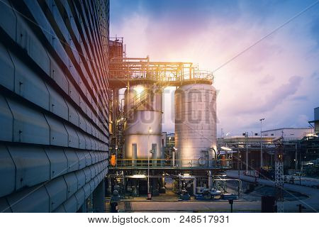 Chemical Tanks In Petrochemical Industry Plant Or Reactor For Chemical Reaction In Factory With Blue