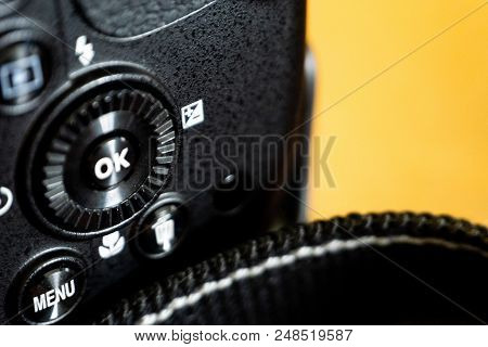 Close-up Macro Shot Of Black Camera Body With Ok Buttons. Selective Focus And Crop Fragment