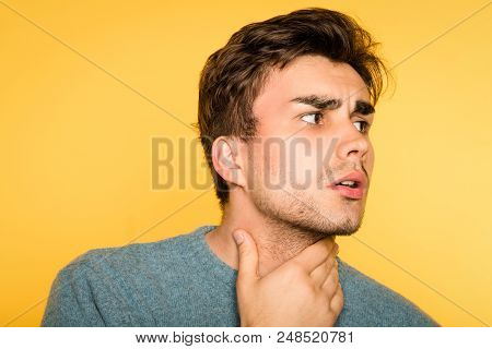 Worried Alarmed Concerned Man Nervously Touching Neck Looking Sideways. Portrait Of A Young Handsome