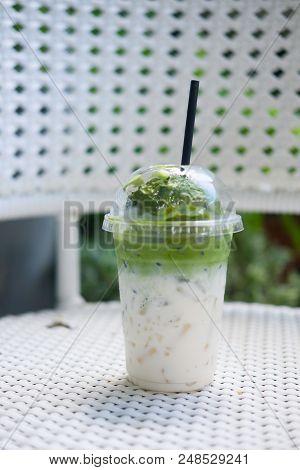 Ice Cream Green Tea Float On Fresh Milk In Plastic Glass (creativity Drink)