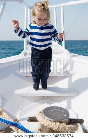 Cute And Carefree. Adventure Boy Sailor Travelling Sea. Child Cute Sailor On Yacht Sunny Day. Boy Ad