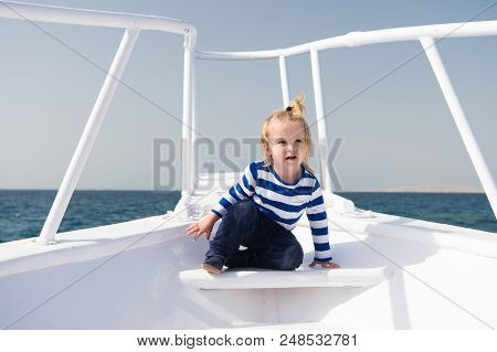 Sea Journey. Baby Boy Enjoy Vacation On Cruise Ship. Child Cute Sailor Yacht Sunny Day. Boy Adorable