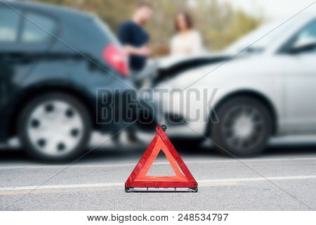 People Discussing After A Car Crash And Trying To Find An Agreement,main Focus On Red Triangle