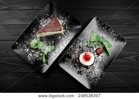 Photo Of Italian Panna Cotta Dessert With Strawberry Sirup And Cake With Nuts And Chocolate On The B