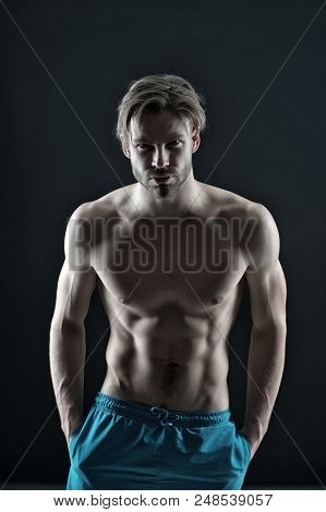 Man With Six Pack And Ab Muscles. Athlete With Fit Body In Shorts. Training And Workout Activity In