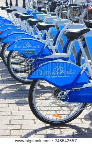 St. Petersburg, Russia - June 25, 2018: Bike Rent Station With New Blue Bikes Lined Up In Row. Bicyc