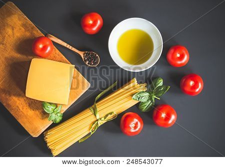 Ingredients For Cooking Pasta On Dark Background