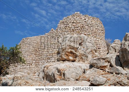 The remains of the medieval Crusader Knights castle above Mikro Chorio on the Greek island of Tilos.