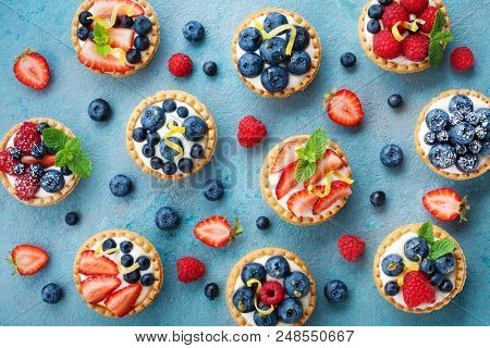 Colorful Berry Tartlets Or Cake For Kitchen Pattern. Pastry Dessert From Above.