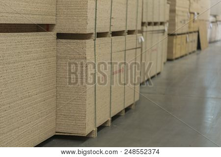 Warehouse of fiberboard and chipboard. Construction Materials. Wooden warehouse. poster