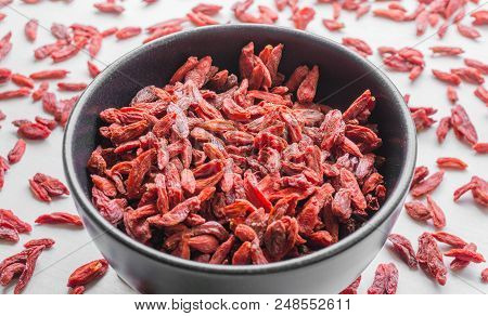 Close-up Of Red Goji Berries In A Bowl. View From Above To Healthy Dried Goji Berries. Natural Food