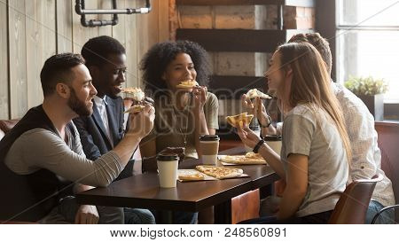 Smiling Multiracial Friends Eating Pizza And Drinking Coffee, Laughing And Having Fun In Restaurant,