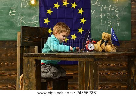 New Technology. Little Child Use Laptop Computer In Classroom With Eu Flag, New Technology. New Tech