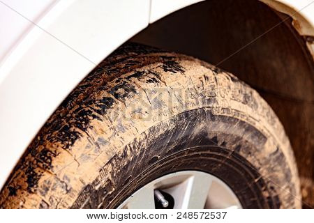 Closeup shot of car wheel covered by clay