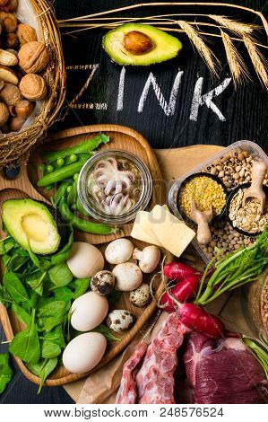 Foods Highest in Zinc as octopus in oil, beef, buckwheat, yellow cheese, spinach, avokado, pea, mushrooms, bean, radishes eggs with inscription Healthy diet food Top view poster